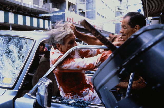 10 May 1989, Panama --- Panamanian Candidate Guillermo Ford Facing Paramilitary Attackers --- Image by © Les Stone/Sygma/Corbis